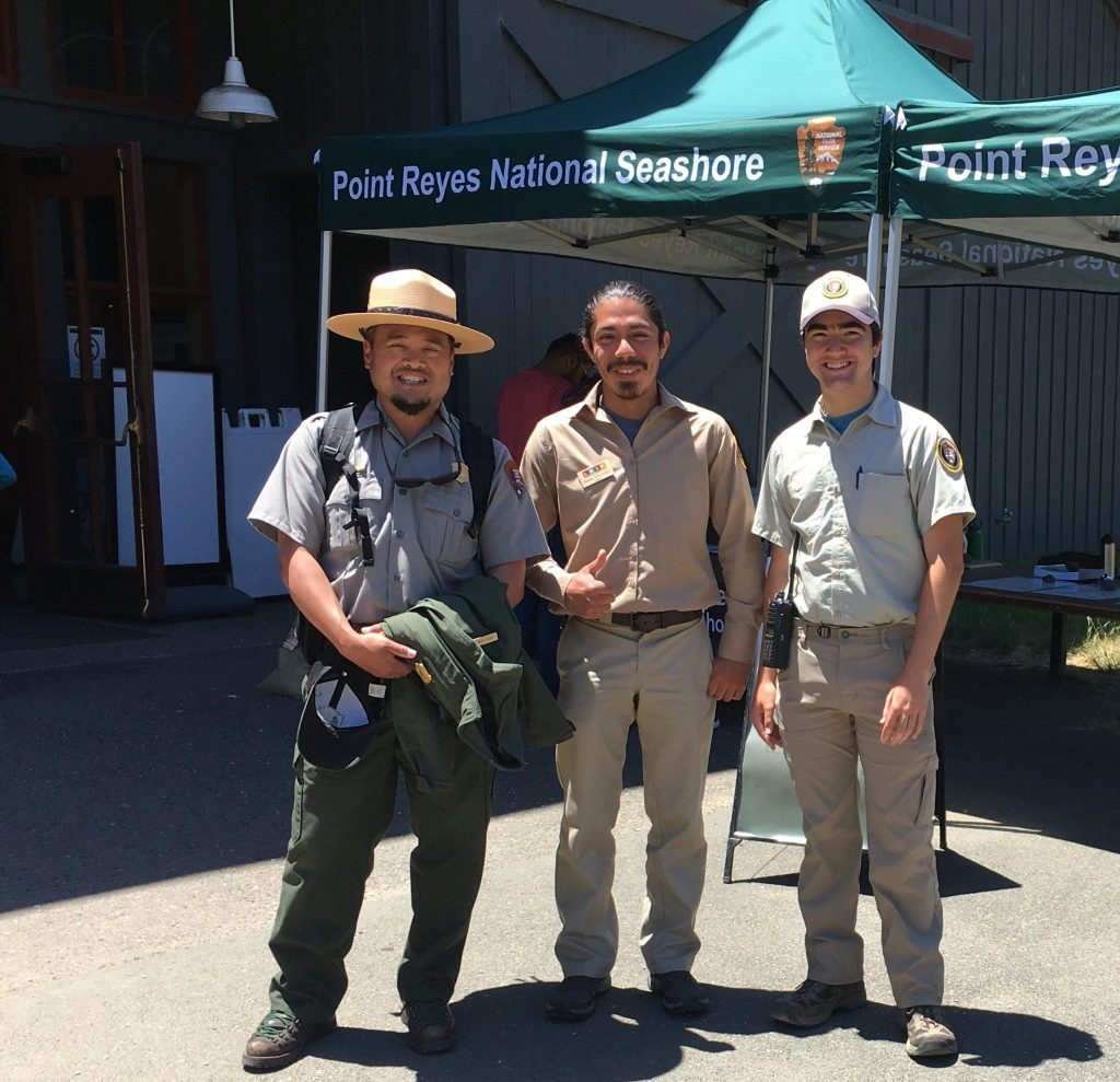 Carlo Arreglo (left), Kevin García López (center), and Diego Morales (right) running visitor center operations