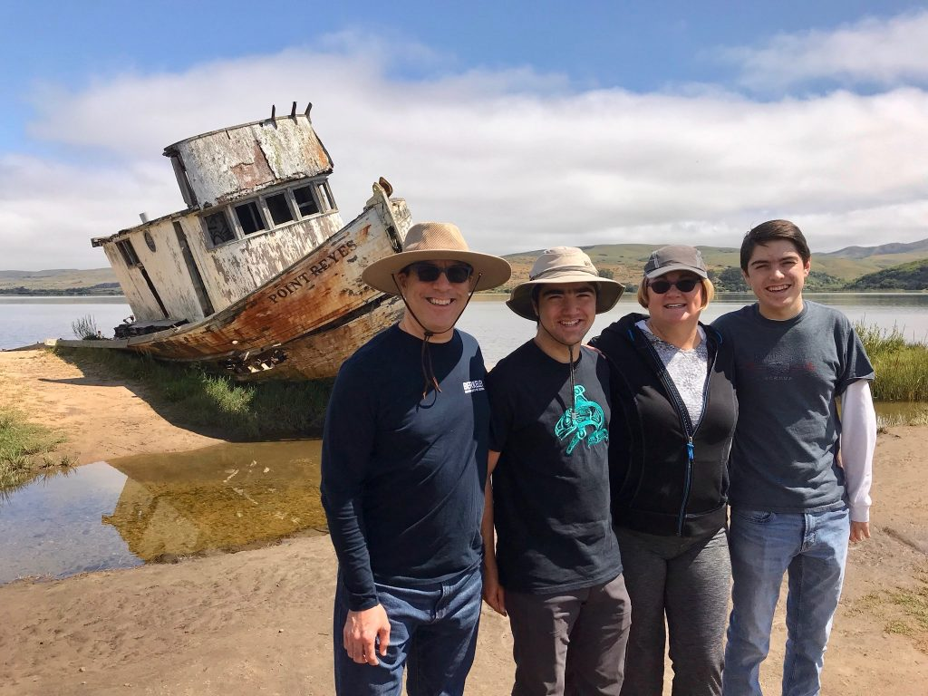 Diego Morales and family visiting the abandoned shipping boat (Photo by unknown).