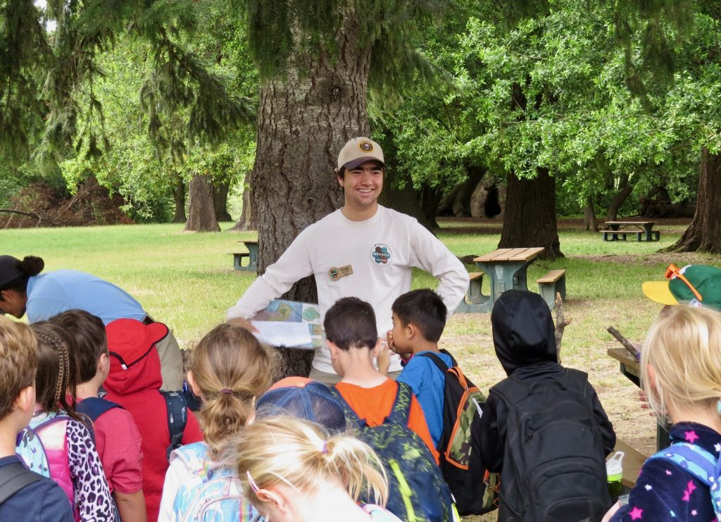 Diego Morales explaining baleen whales to YMCA campers (Photo by Carlo Arreglo)