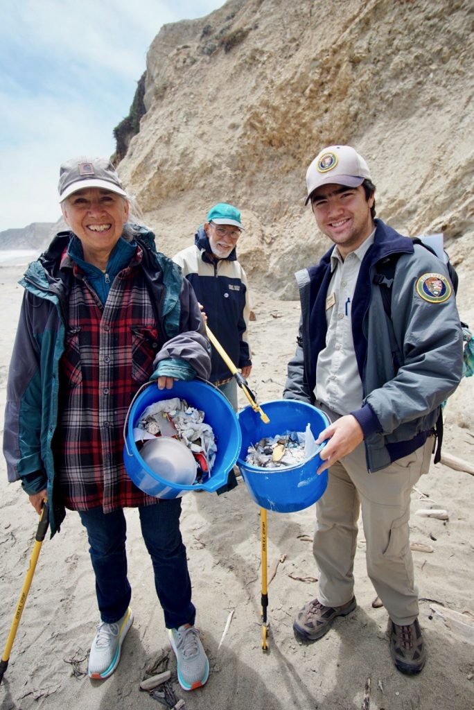 Diego Morales (right) leading park visitors on a beach cleanup (Photo by Anela Kopshever).
