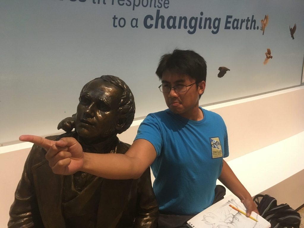 I think your next evolutionary investigation is that-a-way, Chuck. Tut with a statue of Charles Darwin in the NMNH Deep Time exhibit.