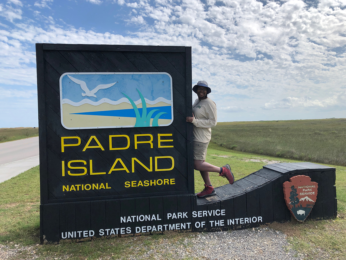 Amani Canada poses on the Padre Island National Seashore welcome sign.