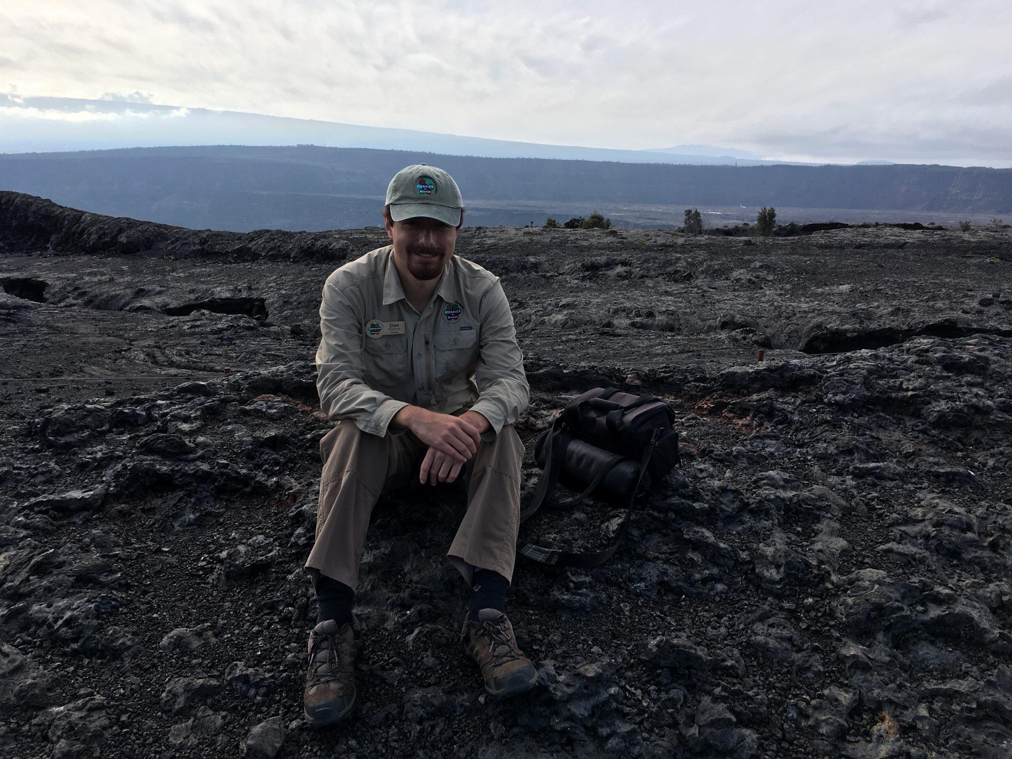 Intern sits on old lava flow