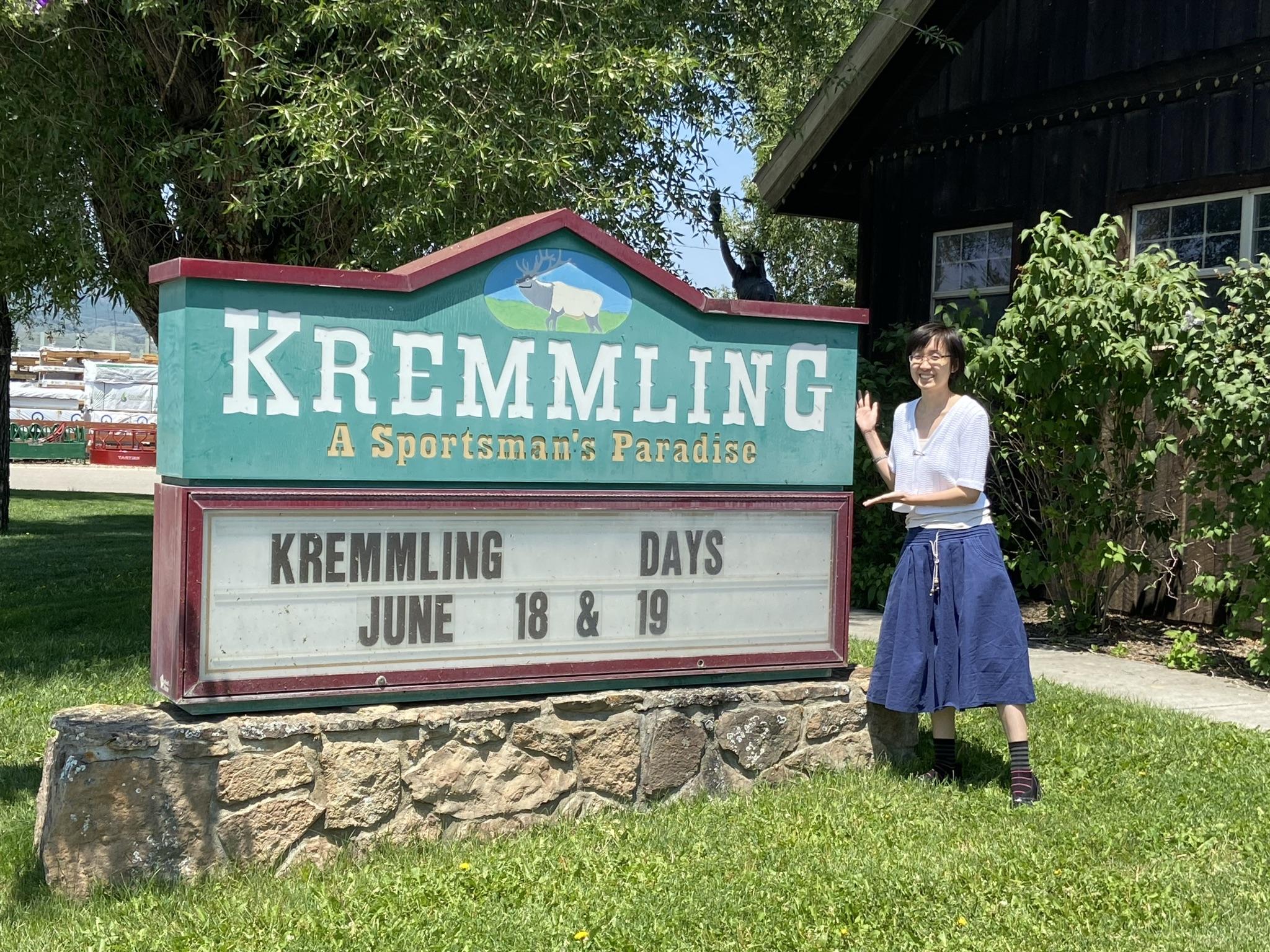 Kremmling Colorado sign and Samantha standing beside it